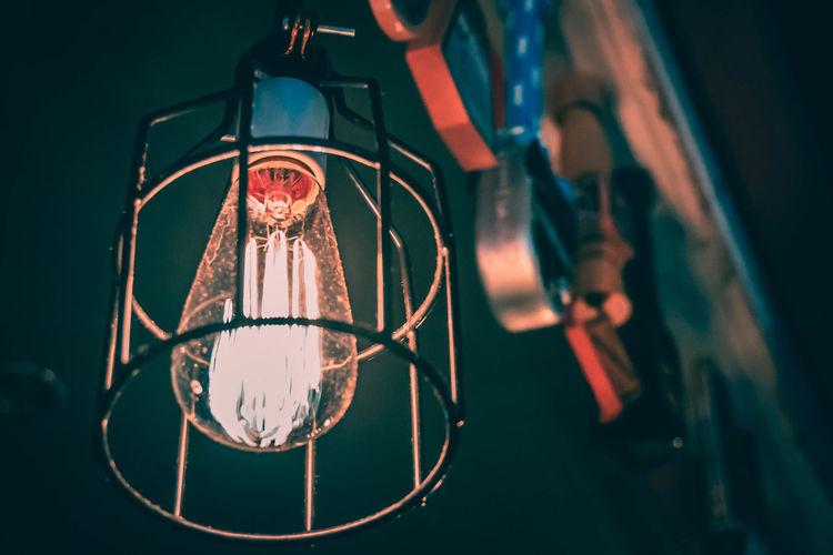Low angle view of illuminated pendant light