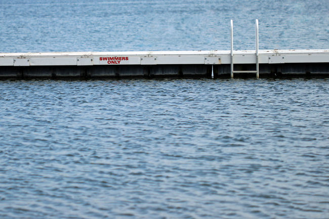 Safety first! Architecture Background Boundaries Built Structure Communication Day Depth Exercise Hazard Health Ladder Lake Nature Outdoors Pier Recreation  Regulations Rippled Rules Safety Sea Selective Focus Swimming Area Water Waterfront