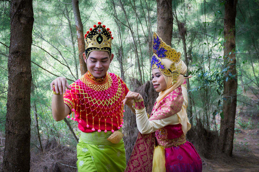 Specific to the villages of Kelantan, where the tradition originated, Mak Yong is performed mainly as entertainment or ritual purposes by couple of dancers. Adult Child Childhood Children Only Crown Day Flower Forest Friendship Girls Happiness Headdress King - Royal Person Mak Yong Outdoors People Portrait Royalty Smiling Togetherness Tree Two People