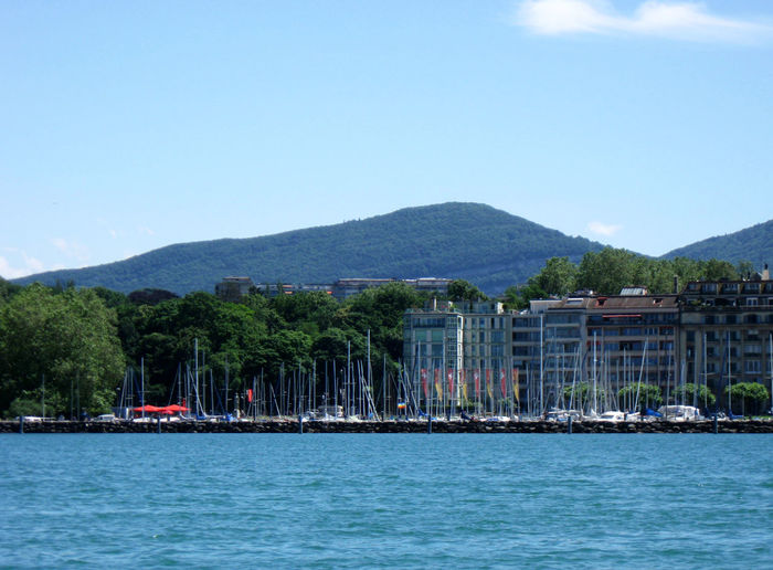 Scenic view of mountains with harbor in foreground