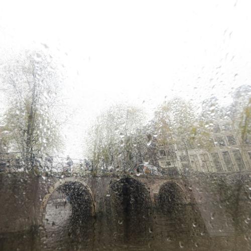 Amsterdam, behind the glass Lluvia En La Ciudad Amsterdam Amsterdamcity Amsterdam Canal Water Paises Bajos Tree Frosted Glass Drop Wet RainDrop Window Spraying Weather Sky Rain