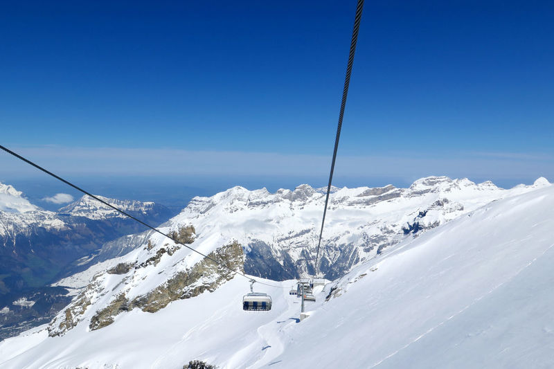 High Angle View Of Ski Lift Over Snow Covered Mountains