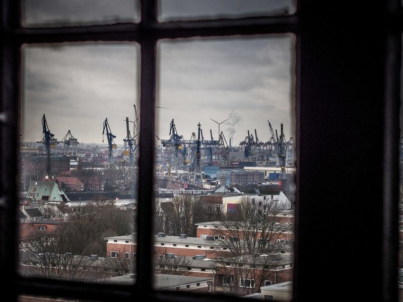 Through the church window 2 Church Hamburg Churchtower Michel St. Michael Diffuse Harbour Port Cranes Logistics Ships Vessels River Elbe