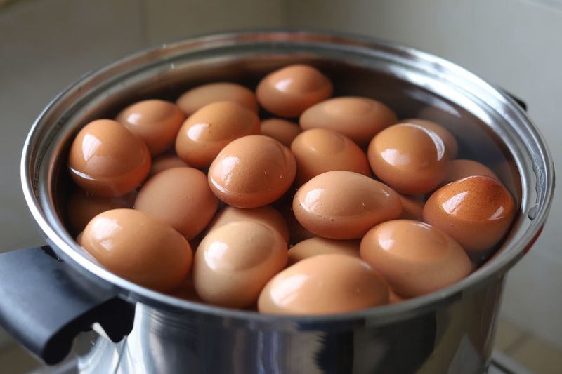 A pot of boiled eggs Food Wellbeing Egg Freshness Healthy Eating Indoors  Container Close-up Still Life Food And Drink Bowl No People High Angle View Large Group Of Objects Raw Food Brown Kitchen Utensil Household Equipment Table Selective Focus Boiled Egg Cooking Protein