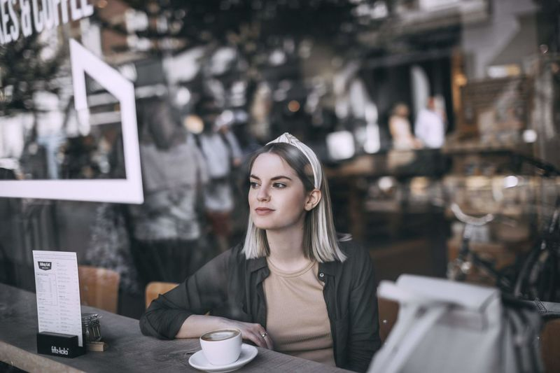 Young woman with coffee cup in cafe