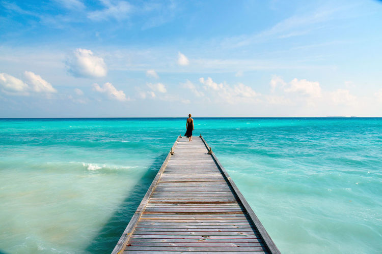 Beauty In Nature Blue Dream Getting Away From It All Girl Horizon Over Water Idyllic Leisure Activity Lifestyles Maldives Nature Pier Rear View Relaxation Scenics Sea Sky Summer The Way Forward Tranquil Scene Tranquility Vacations Water Weekend Activities Woman