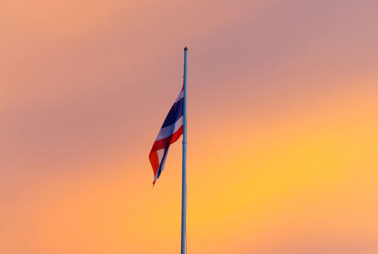 Low Angle View Of Thai Flag Against Sky During Sunset