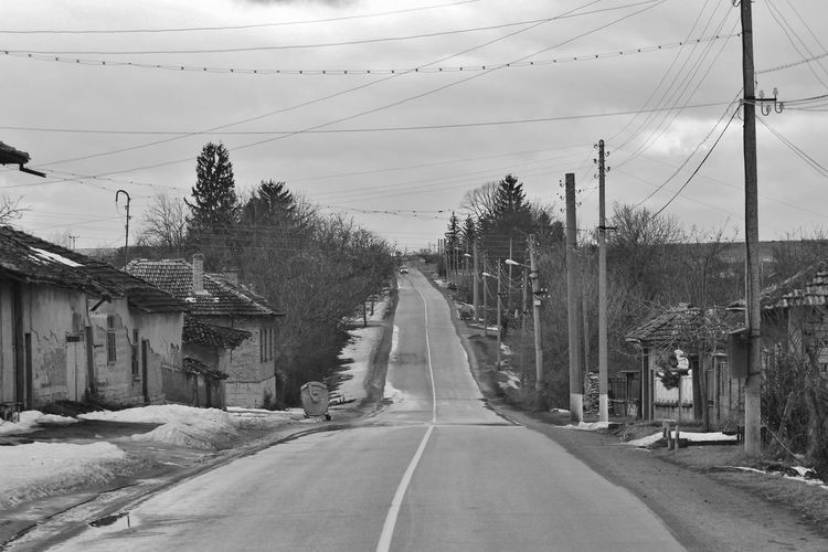 View Of Road In Town With Dilapidated Houses
