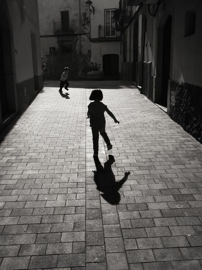 Children playing on paved street