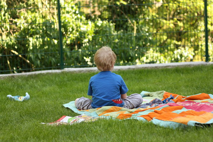Blond Hair Boys Child Childhood Children Only Grass Loneliness Lonely Lonely Boy One Boy Only One Person Picnic Blanket Rear View Sitting Portrait From Behind Children Childphotography The Portraitist - 2017 EyeEm Awards