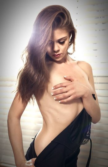 Young woman undressing