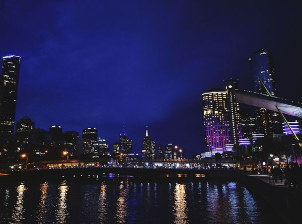 EyeEm Selects Melbourne City Skyscraper Urban Skyline Cityscape Building Exterior Reflection Travel Destinations Nightlife Outdoors Downtown District Night Illuminated Architecture City Life Water Modern Built Structure Lights