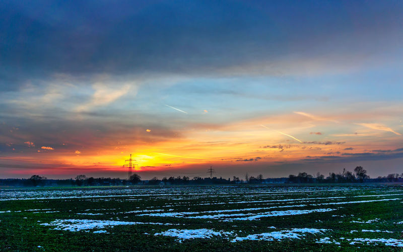 Powerlines at sunset Beauty In Nature Cloud - Sky Cold Temperature Dramatic Sky Nature No People Outdoors Romantic Sky Scenics Sky Sunset Tree