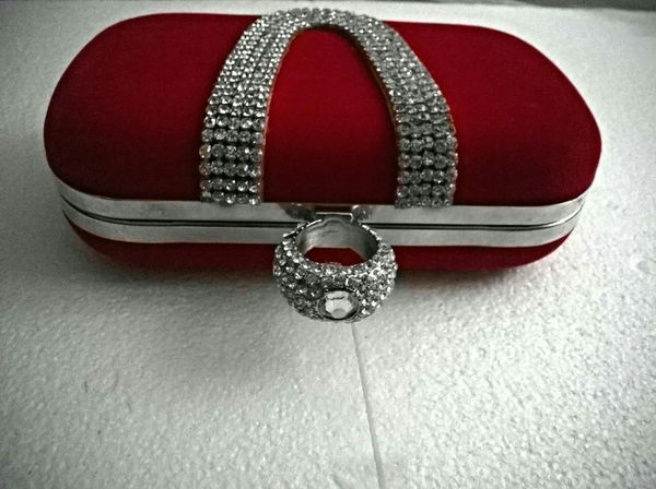 A red clutch purse on styroform. Taking Photos Purses Fashion Accesories Eye4photography  Red Crimson Ruby Jewels