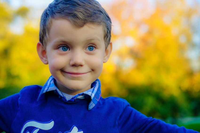 Blue Eyes FUJIFILM X-T10 Autumn Boys Childhood Close-up Cute Day Focus On Foreground Front View Fuji Fujifilm Happiness Headshot Innocence Lifestyles Looking At Camera Nature One Boy Only One Person Outdoors People Portrait Real People Smiling Tree Wasiak