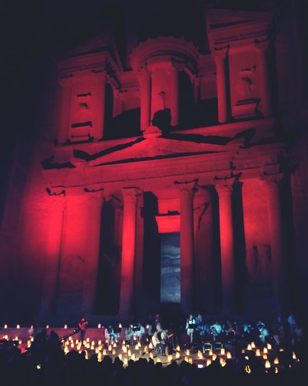 Petra in red Crowd Illuminated Tourist Attraction  Colors History Religion Architecture Ancient Civilization Night King - Royal Person Travel Destinations Travel Old Ruin Ancient Spirituality Building Exterior Postcard Arts Culture And Entertainment Jordan Petra Petra, Jordan Petra Jordan Built Structure
