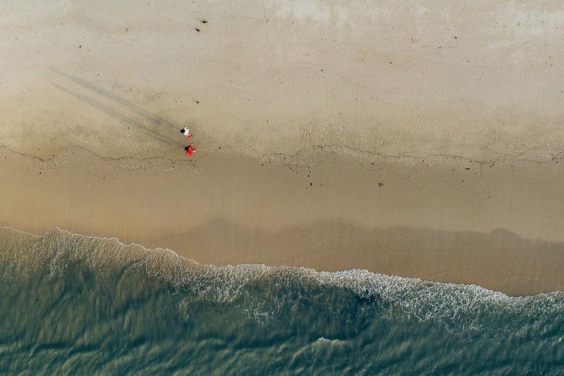 People walking by seaside