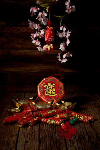 Chinese New Year Lunar New Year Good Luck Decoration Festive Wooden Table Luck Mascot Flat Lay Celebration Craft Firecrackers Ornament Gold China 2020 2019 Pig Minimal Sales Envelope Celebrations Flowers Lucky Tradition Symbol Red Fu Background Festival Spring Holiday Traditional Gold Culture Oriental Fortune Asian  ASIA Packet Plum Blossom Design Celebrate Greeting Prosperity Auspicious Money Happiness Firecracker Ingot Indoors  Wood - Material No People Still Life Text Close-up Event Flower Plant Flowering Plant Hanging Freshness Art And Craft Christmas Ornament