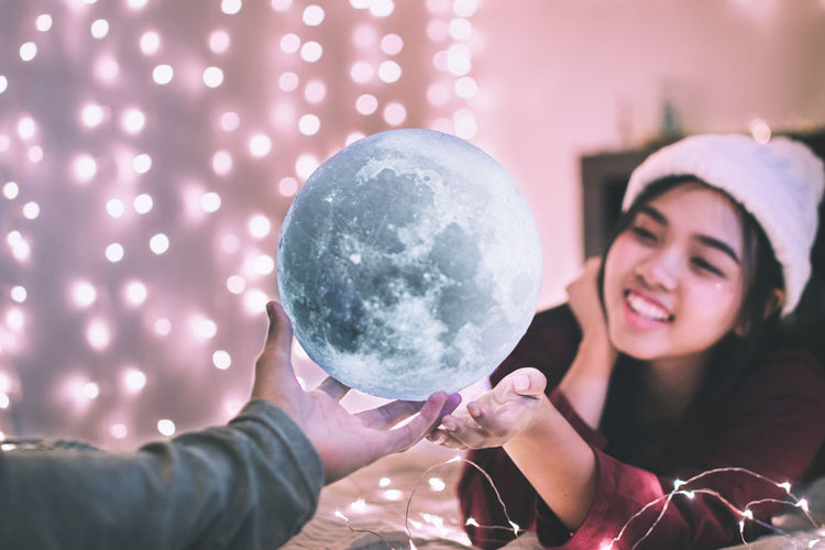shoot for the moon even if you miss you'll land among the stars.🌕 Celebration Happiness Light Lights Live for the Story Moon Moon Shots Portrait Of A Woman Bokeh Bokeh Photography Focus On Foreground Happiness Headshot Holding Human Hand Lifestyles Light And Shadow Moon Light Moon Surface Moon_collection Moonlight Portrait Smiling Vintage Young Women