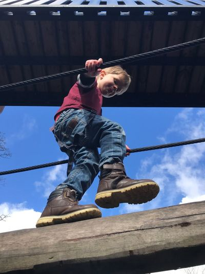 Playtime Young Boy Fun Boy Outdoor Play Outdoor Play Equipment Exploring Playing Games Playing Low Angle View Full Length One Person Nature Childhood Child Sky Real People Day Leisure Activity Outdoors Sunlight