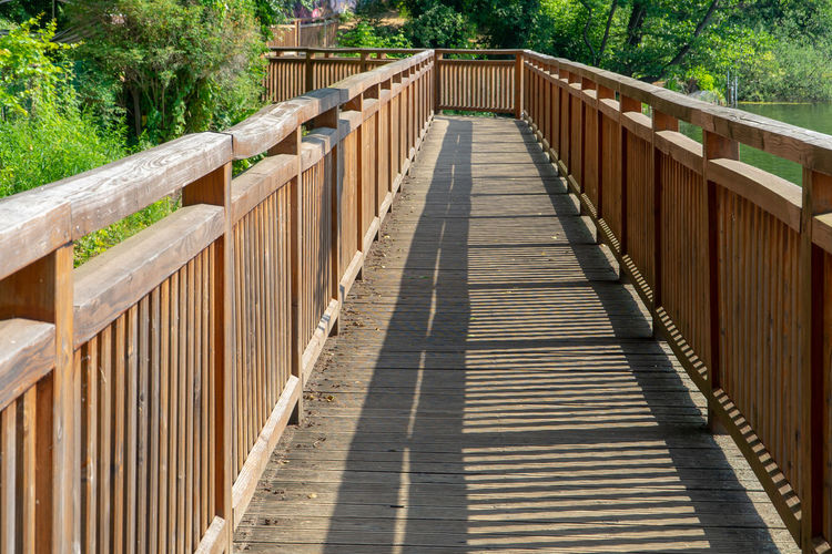 Wooden footbridge on footpath