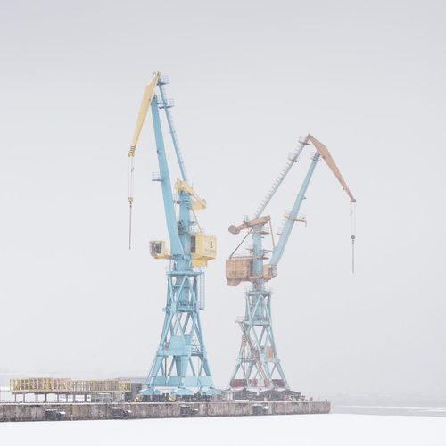 cranes at dock against sky Baltic Sea Freezing Frozen Harbor Industrial Industry Winter Wismar Harbor Cold Cold Temperature Crane - Construction Machinery Day Dock Docklands Germany Harbor View Industrial Landscapes No People Outdoors Philipp Dase Sky Snow Snow Storm Studio Shot Tank Ship Water White Background Wismar