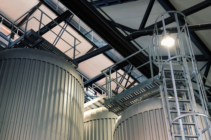 These are fermentation tanks, a place where the beer matures and then gets ready to be bottled... or actually put in aluminum cans as they don't usually bottle beers at Stone // Low Angle View Architecture Built Structure No People Indoors  Day FUJIFILM X-T10 XF18-55mmF2.8-4 R LM OIS F/3.6 ISO 2000 via Fotofall