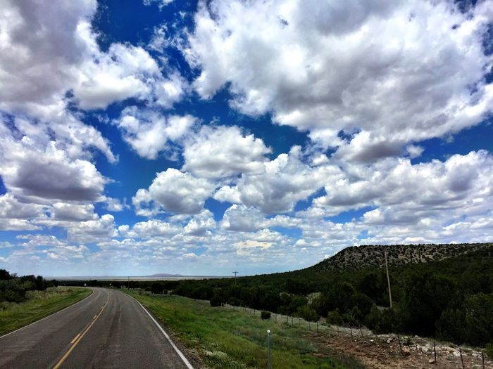"""Endless"" A road, a journey into endless clouds, mesa moments and high desert magic. Roads Roadside America Roadsidephotography Clouds Clouds And Sky Cloudscape Endless Travel Newmexico NewMexicoTRUE Newmexicophotography Landscape Landscape_Collection Landscape_photography Newmexicoskies"