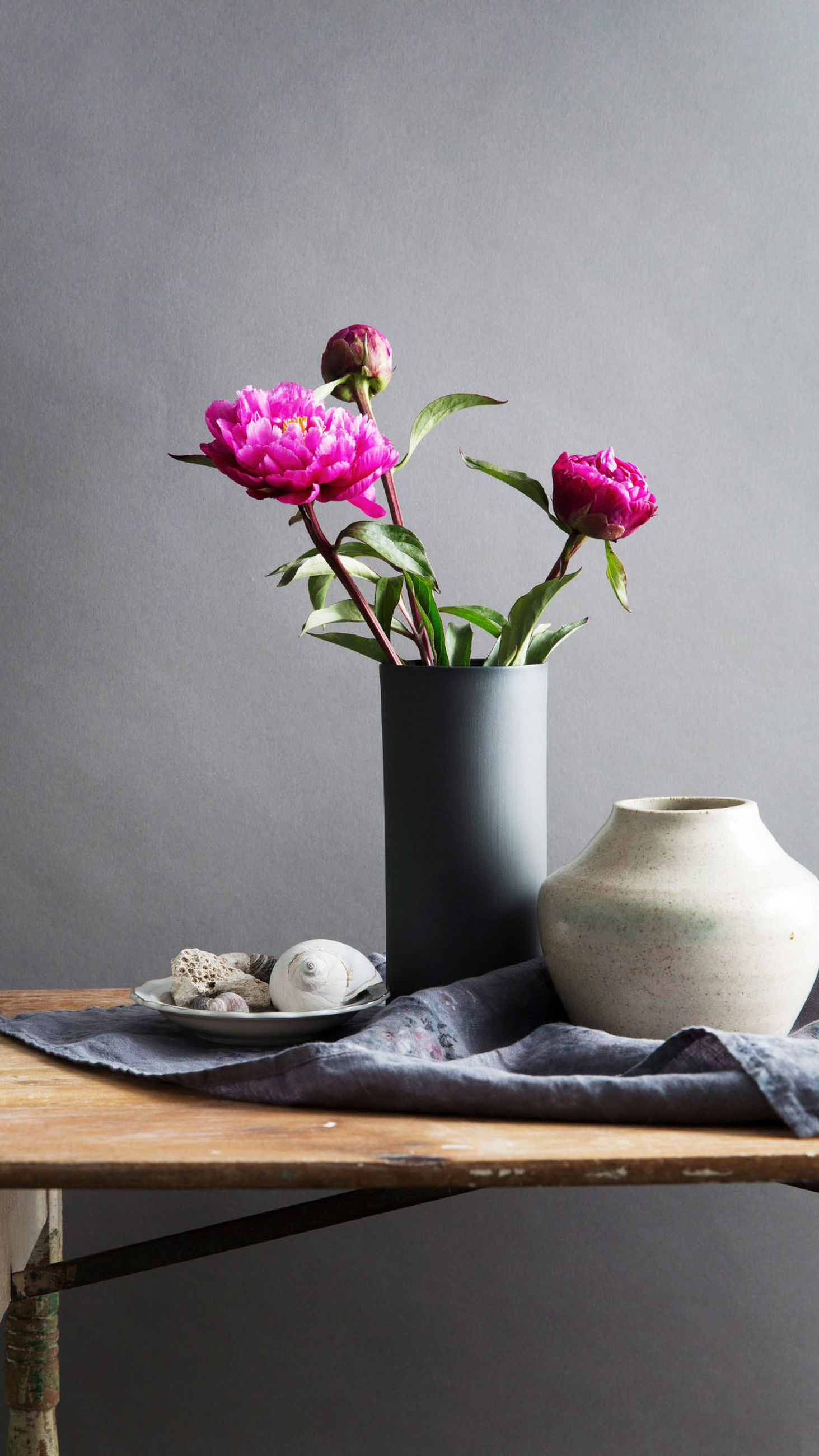 flower, freshness, growth, vase, potted plant, plant, wall - building feature, fragility, flower pot, pink color, indoors, decoration, beauty in nature, selective focus, close-up, nature, in bloom, bunch of flowers, blossom, flower arrangement, botany, springtime, houseplant, house plant, petal