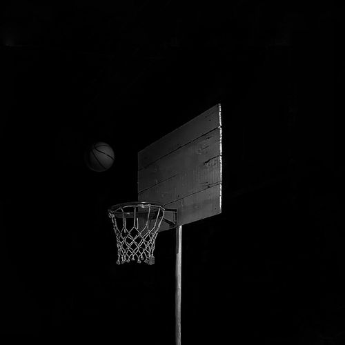 Low angle view of basketball hoop at night
