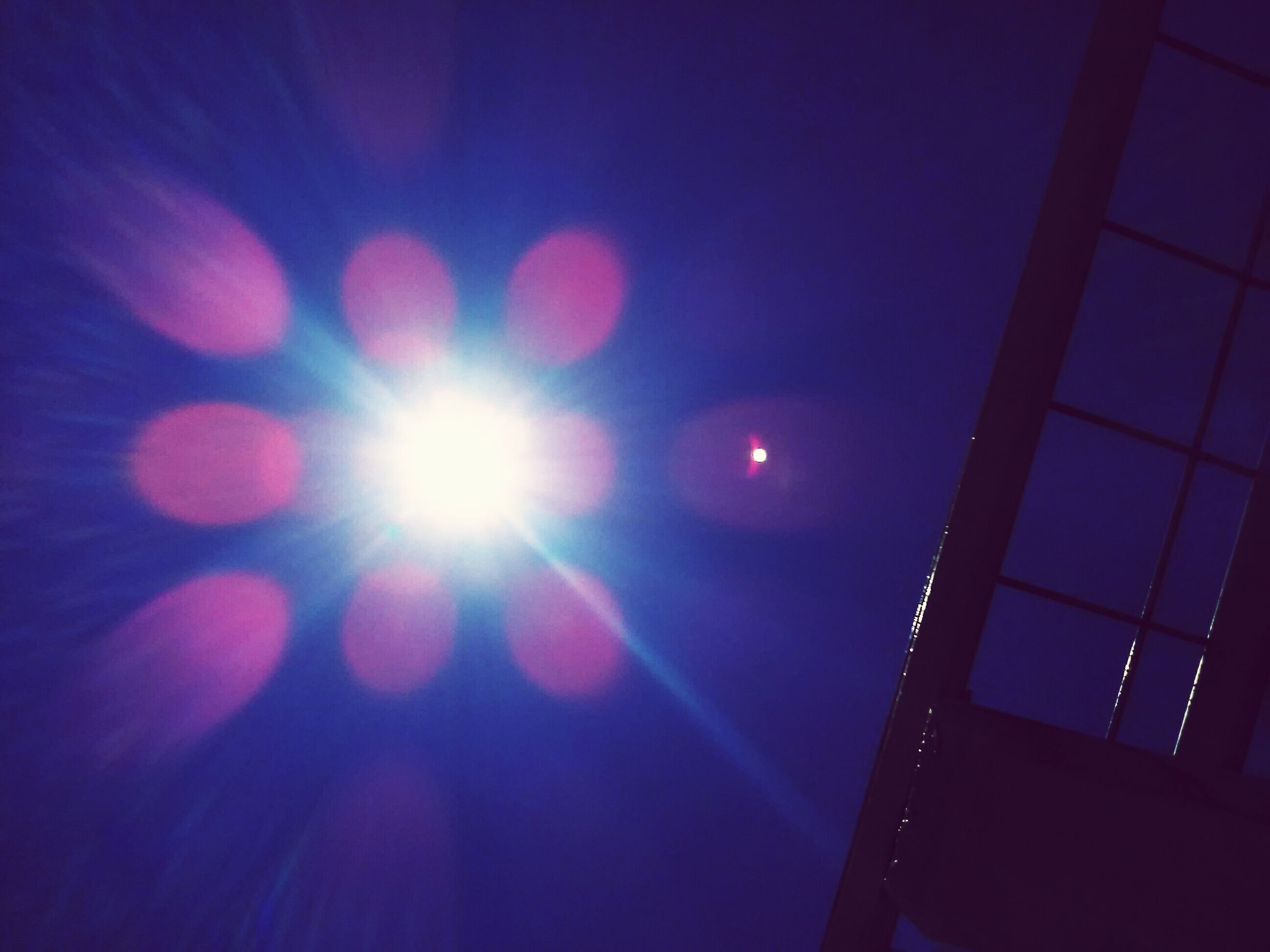 illuminated, no people, sun, lighting equipment, low angle view, sky, outdoors, close-up, nature, moon, spotlight, solar eclipse