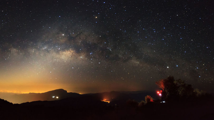 Panorama Milky Way Galaxy with light city at Doi inthanon Chiang mai, Thailand Astronomy Beauty In Nature Galaxy Mountain Nature Night No People Outdoors Scenics Sky Star - Space Starry Tranquility