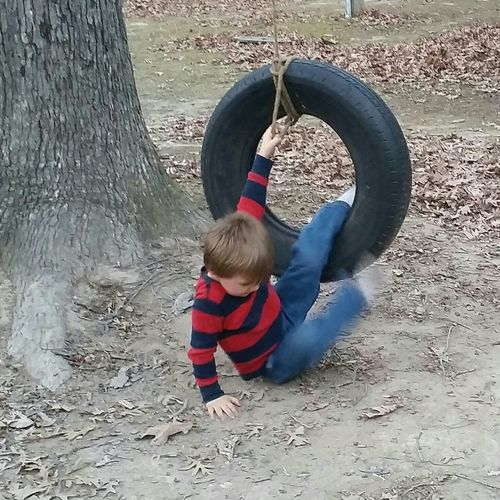 Tire Swing Fun Motion Happiness Memories Preschool Boy Missouri Ozarks United States Childhood One Person Full Length Sand Day People Child Blond Hair Outdoors