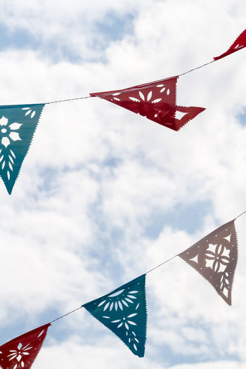 Bunting Bunting Close-up Cloud Cloud - Sky Day Decoration Fabric High Section Low Angle View Multi Colored No People Outdoors Red Sky Wind