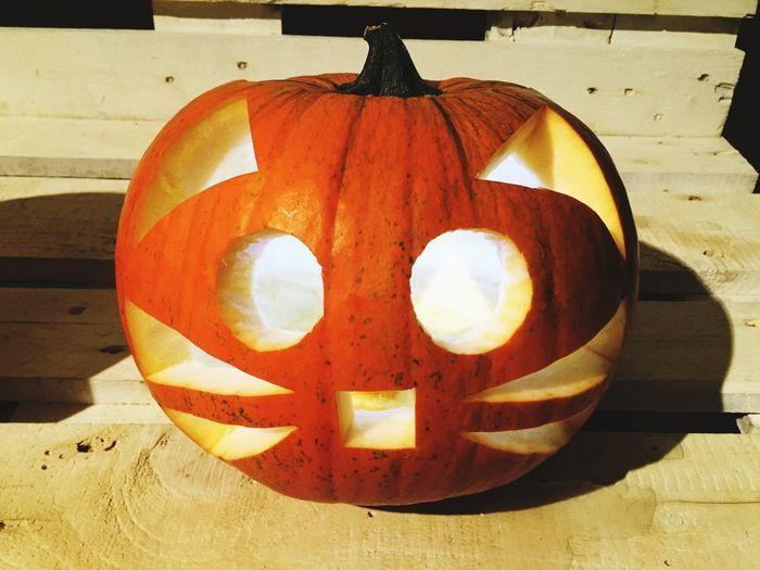 Close-up of pumpkin lantern on stone wall during halloween