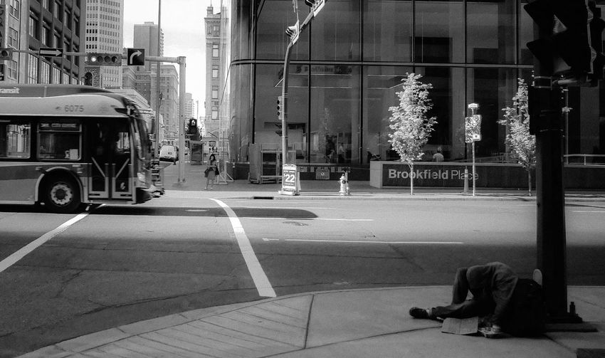 Down town. Panhandling Monochrome Downtown Calgary Downtown Down Street People City Real People Photography Street People Homeless City Transportation Building Exterior Street Built Structure Architecture Mode Of Transportation Road Outdoors