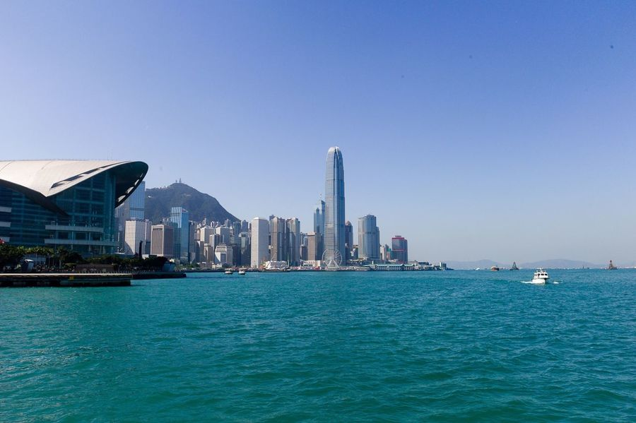 The Great Outdoors - 2016 EyeEm Awards Hong Kong Victoria Harbour Central Sunshine Skyscrapers Blue Sky Modern Architecture Ferris Wheel Tall Buildings Sunny Day Busy City Energetic