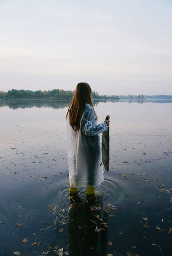 Water One Person Lifestyles Women Leisure Activity Long Hair Beauty In Nature Non-urban Scene Tranquility Outdoors Nature Scenics - Nature Standing Rear View Lake Lake View Fish Fisherman Fishing Morning Morning Light Autumn Nature Nature Photography Facing Away