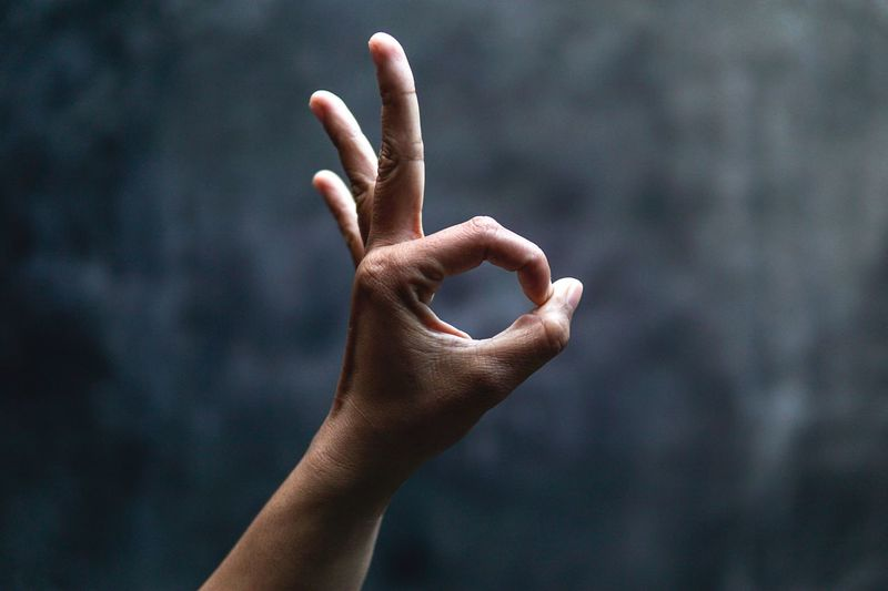 Cropped image of hand gesturing ok sign