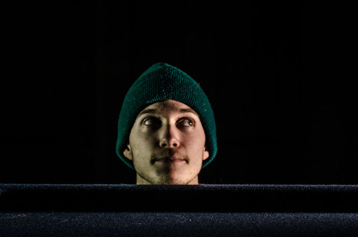 Center HEAD Hat Pooltable Man Young Adult Green Balck Background