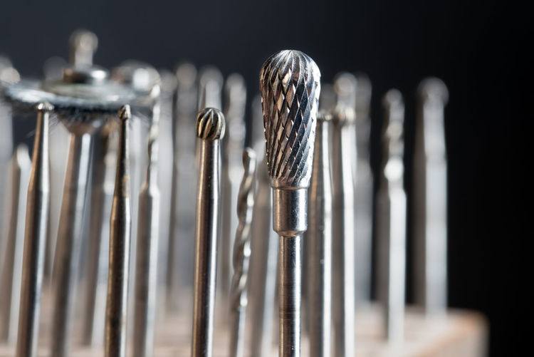 milling heads on a goldsmith workplace, macro shot of jewelry tools against a dark background HEAD Production Work Bitcoin Close Up Craft Detail Drill Drilling Equipment Goldsmith Group Of Objects Handicraft Jewelry Job Macro Metal Mill Milling Occupation Seats Sharp Steel Tool Work Tool