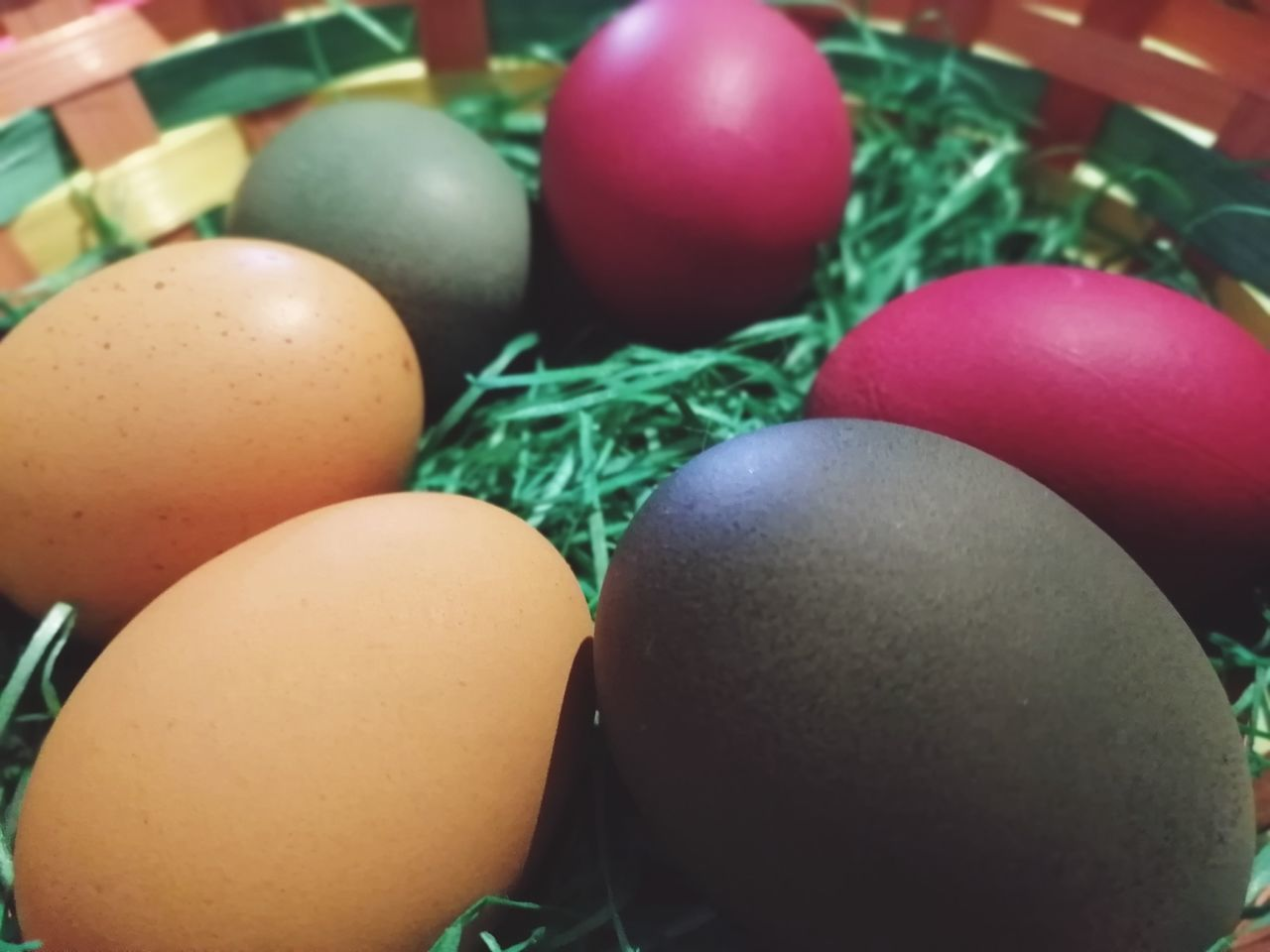 CLOSE-UP OF MULTI COLORED EGGS IN CONTAINER