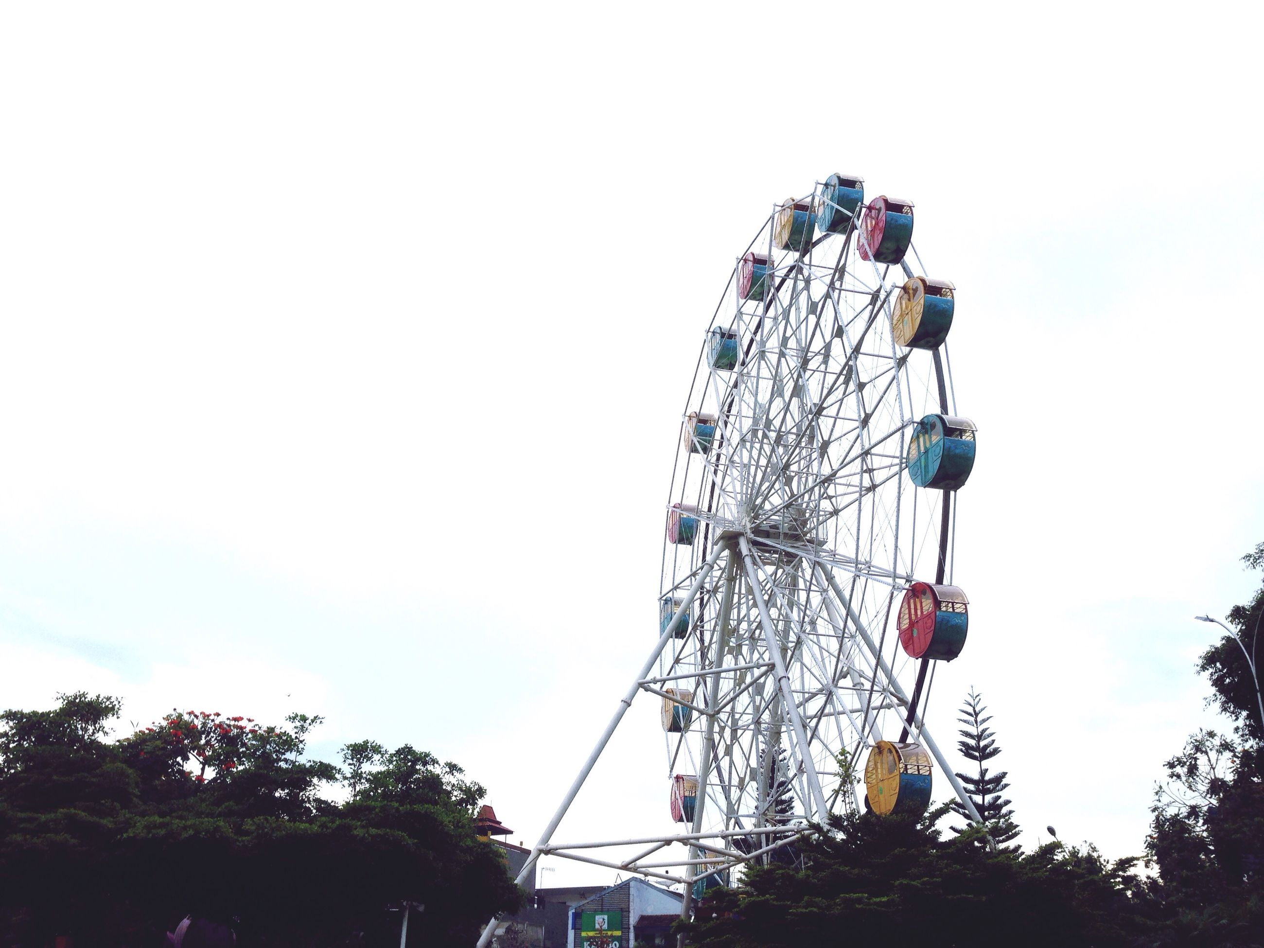 ferris wheel, low angle view, amusement park, clear sky, outdoors, sky, no people, day, big wheel