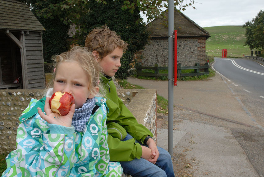 Waiting for the bus Apple Boy Bus Stop Childhood Children England Family Girl Leisure Activity Nikon Outdoors Real People Seven Sisters Siblings South Downs Sussex Uk Waiting