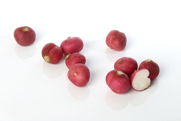 High angle view of apples on white background