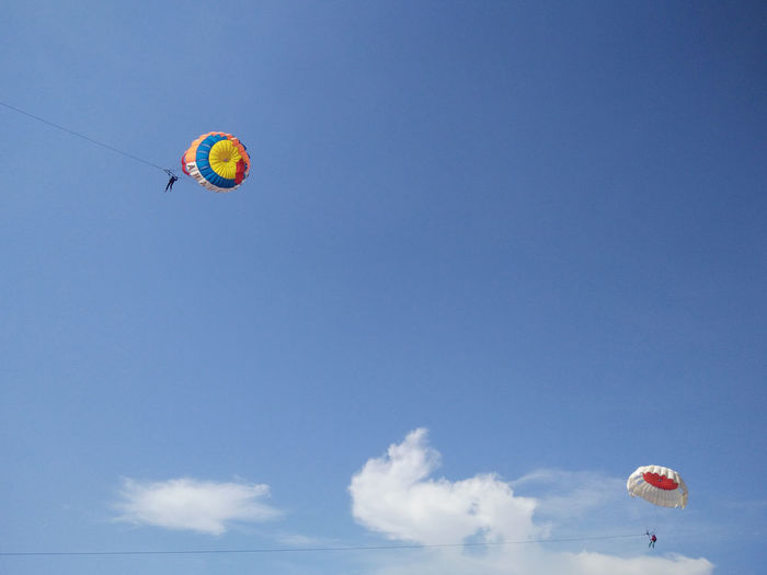 Adventure Blue Day Extreme Sports Flying Freedom Fun Leisure Activity Lifestyles Low Angle View Mid-air Multi Colored Outdoors Parachute Paragliding Sky Unrecognizable Person Vacations Shore Bali, Indonesia Tanjungbenoa Nusadua Watersports Parasailing
