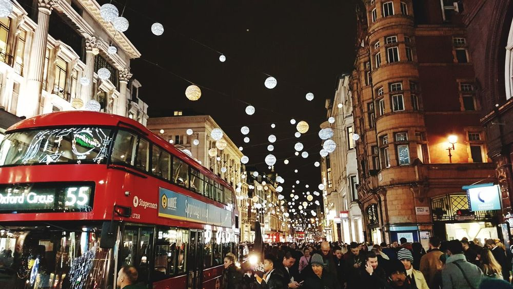 Christmas Decorations in London Travelawesome Christmas Decoration Chrismas Lights London London Streets Red Bus Illuminated Architecture Built Structure Large Group Of People Night Crowd Low Angle View City Building Exterior People Outdoors