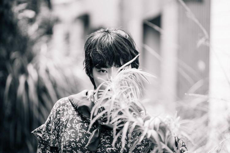 Portrait of boy holding leaf