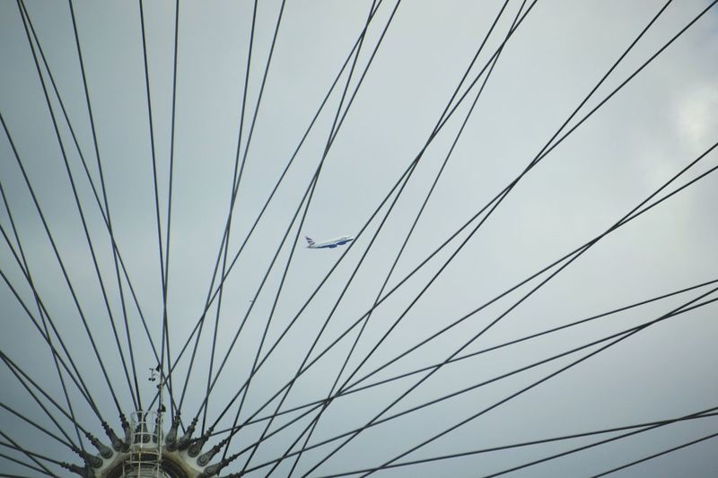 Airplane between the spokes of the London Eye ✈ London Eye Airplane Spokes London The Moment - 2015 EyeEm Awards British Airways Perfect Moment Perfect Timing Capturing Freedom Capture The Moment Seeing The Sights
