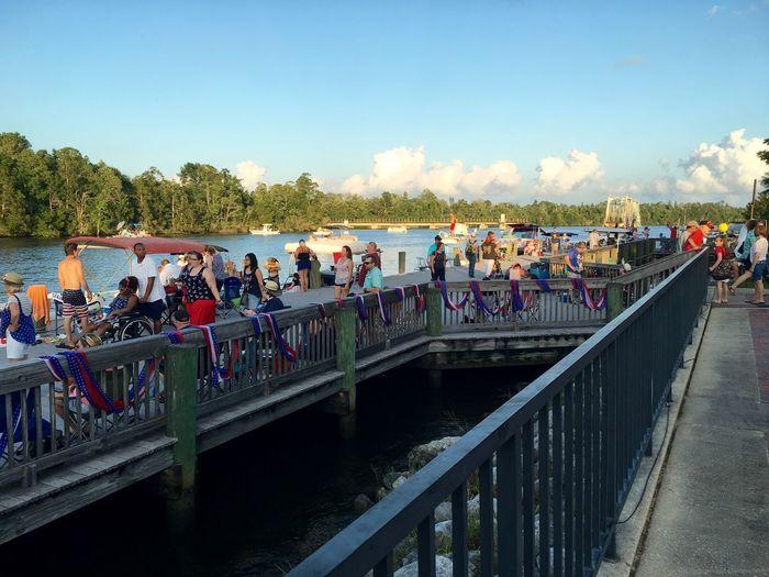 Tourists on bridge over river